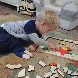 A Toddler Doing Our US Map Puzzle